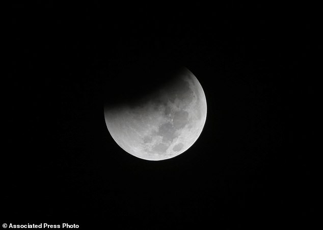 Spectators across the UK can expect to see a 'Super Blood Wolf Moon' lunar eclipse which will happen next week. he eclipse should be visible in North and South America, Greenland, Iceland, Ireland, Great Britain, Norway, Sweden, Portugal and the French and Spanish coasts (file photo)