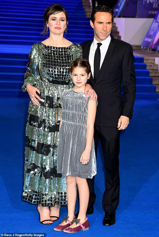Family:Emily Mortimer dazzled as she arrived at the European premiere of Mary Poppins Returns at the Royal Albert Hall in London on Wednesday., accompanied by husband Alessandro Nivola and daughter May