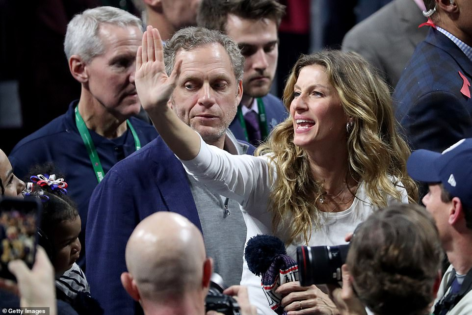 Stunning: Gisele waved to the fans as she made her way down the field