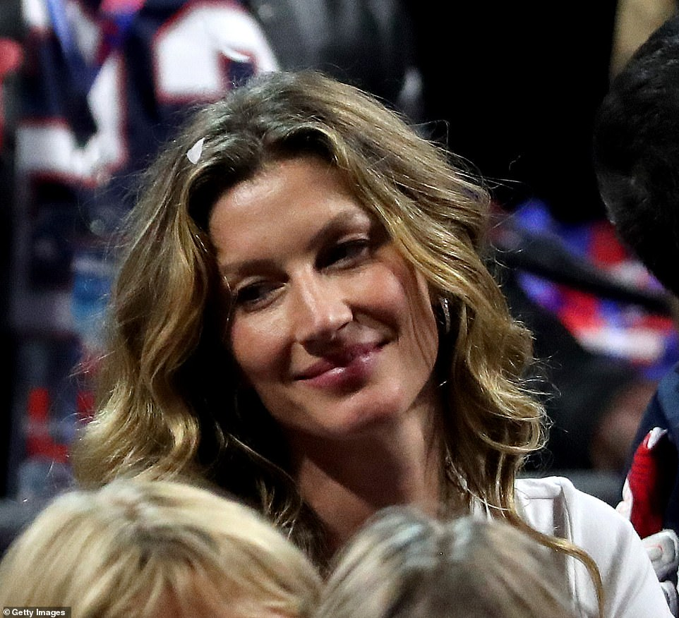 Look of love: The Brazilian beauty was joyful after her husband's triumph in the low-scoring affair