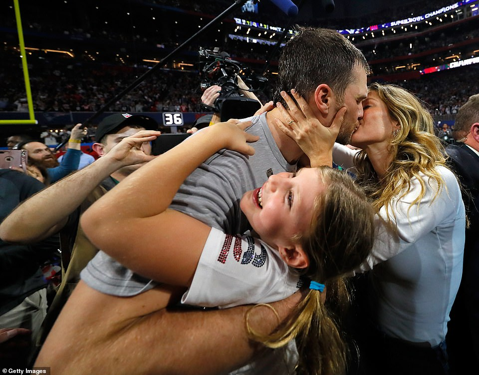 Man of the moment: Brady hugged his daughter and kissed his wife after the game