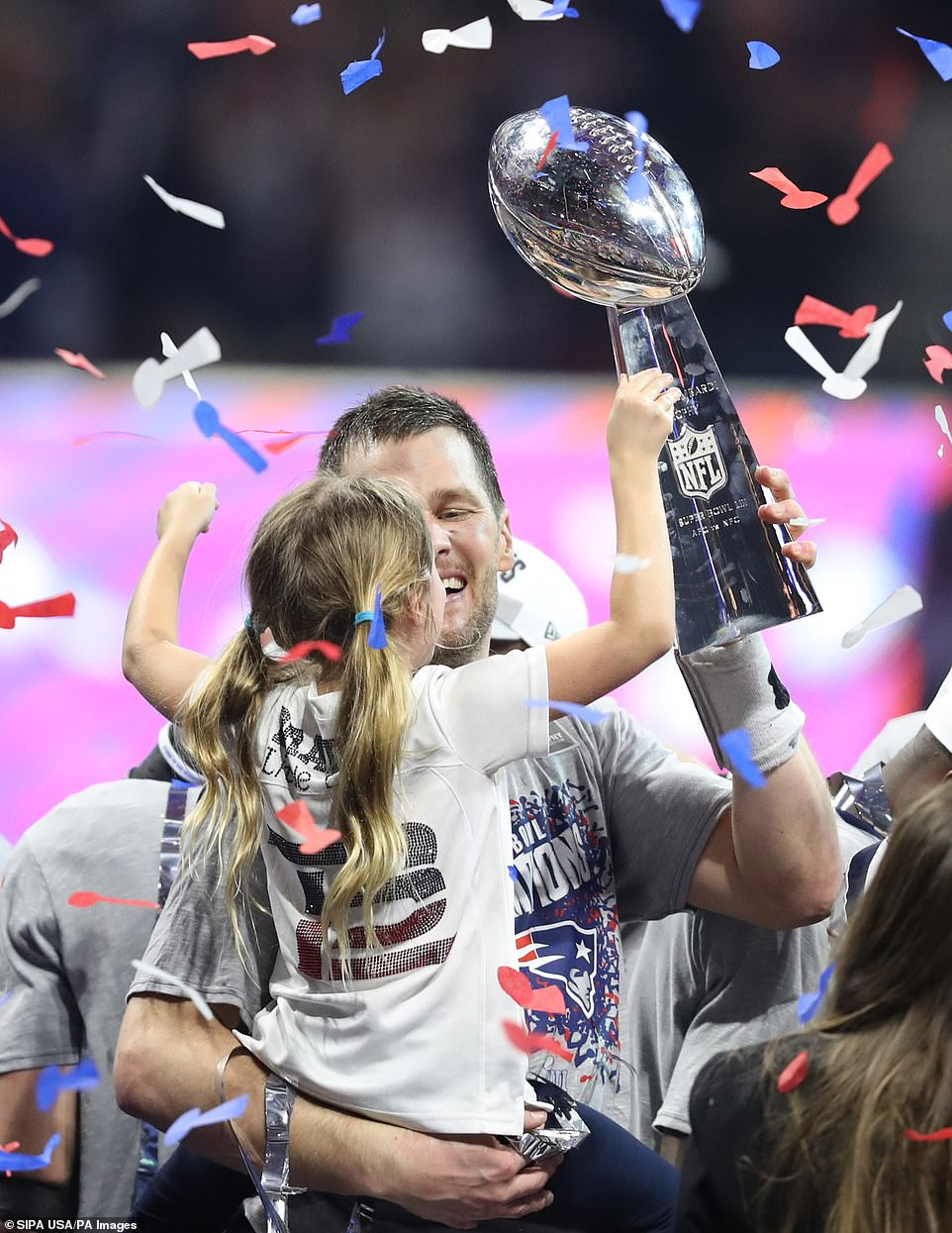 Unforgettable: Brady held his daughter with one arm as he hoisted up the Super Bowl trophy with the other