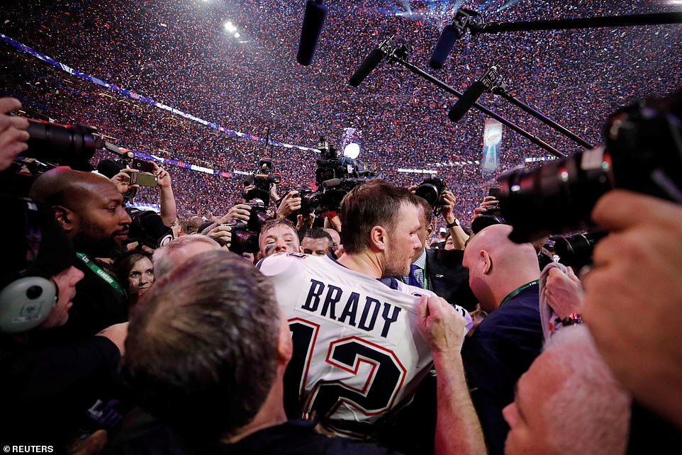 All hail the king! The signal caller absorbed the moment as confetti rained down after the Pats' win