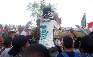 """A protester with the words """"Halfa"""" on his T-shirt at a sit-in at the military HQ in Khartoum, Sudan - Monday 8 April 2019"""