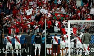 Peru's players celebrate their semi-final win  in Porto Alegre which secured a rematch against Brazil.