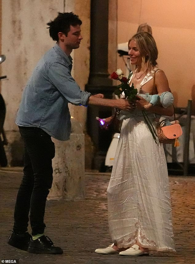 Roses for a rose: Sienna Miller proved there is absolutely no acrimony in her platonic friendship with her ex Tom Sturridge as they larked around in Rome