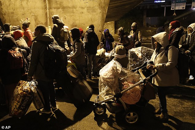 Children were among those ushered out of the camp at La Chapelle, in the north of the city, and on to buses so they could be taken to temporary accommodation