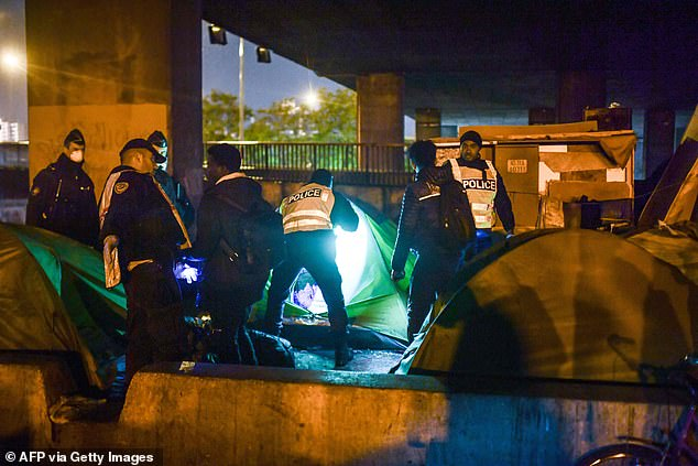 It is thought hundreds of those living at the camp were attempting to reach Britain, since they were living next to Eurostar lines and underneath a motorway leading to Calais