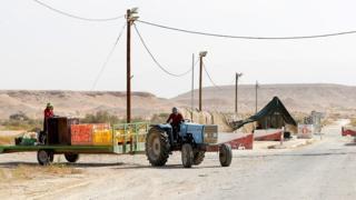 Thai farm workers drive along the Israeli-Jordanian border on October 23, 2018