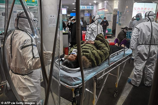 Australia is seeking permission from Chinese authorities to allow its citizens to depart Wuhan. Pictured is a coronavirus patient in a Wuhan hospital