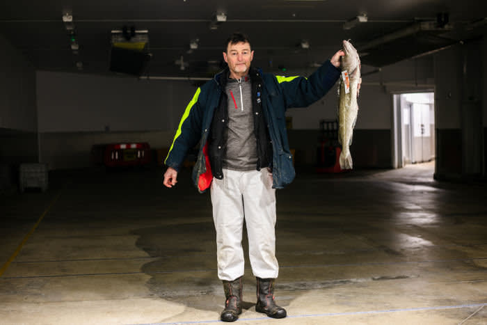 Gary Mitchell, fish buyer stands for a portrait at Peterhead Fish Market