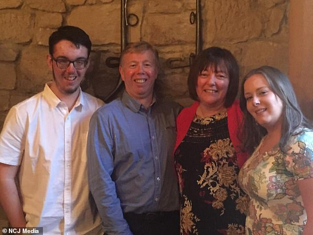 Jake, pictured, with his family, is the first man in the country to receive the pioneering treatment which experts believe may be able to reverse the damage to his eyesight