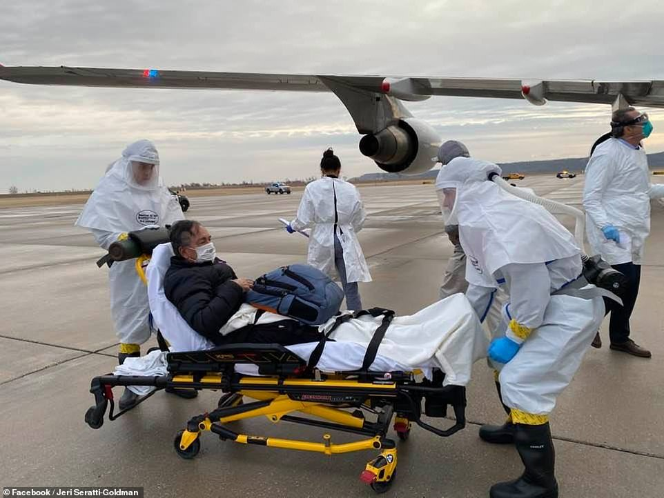 Jeri Goldman, says her husband, Carl, has tested positive for the virus at UNMC. Pictured: Carl arrives in Nebraska and is placed on a stretcher to be taken to Nebraska Medicine