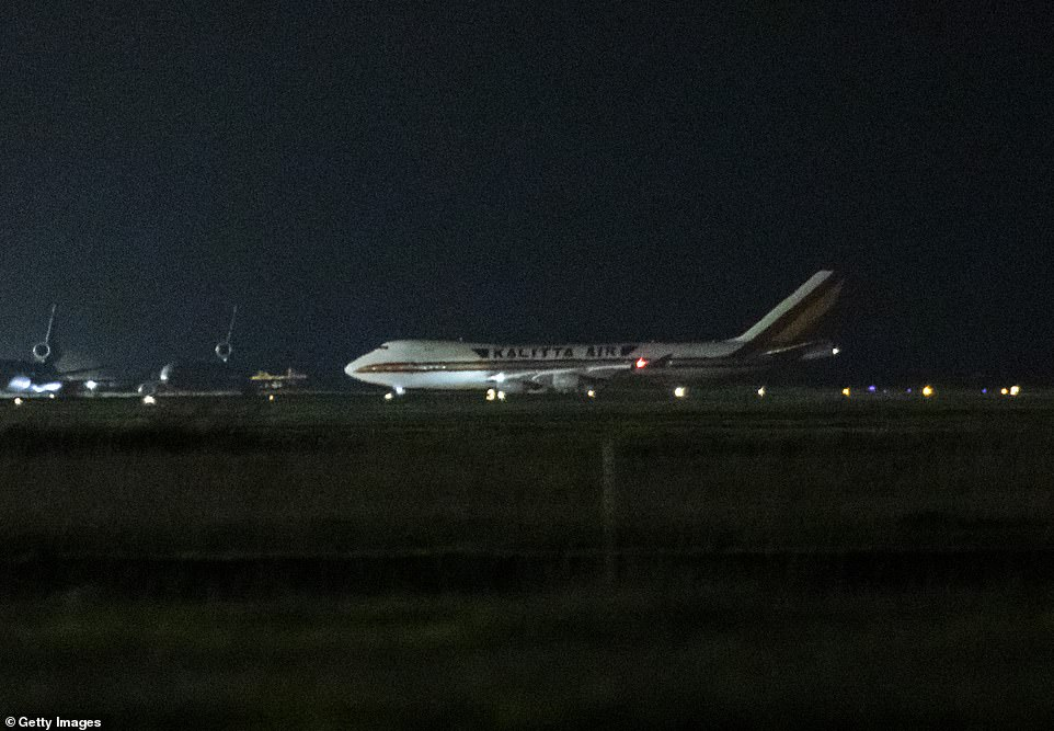 Despite the US earlier saying no infected passenger would be allowed to leave, those who tested positive were still allowed to board the planes because they did not have symptoms. Pictured: One of the two planes landing at Travis Air Force Base in California