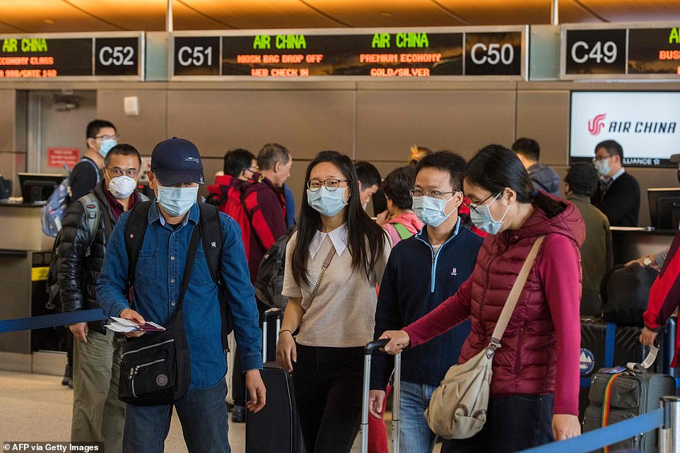 Data from the Department of Homeland Security reveals 14 foreign nationals were turned away at US airports while 126 were blocked from entering at land ports and borders between February 2 and February 12. Pictured: Passengers wear masks as they check in to their Air China flight to Beijing, at Los Angeles International Airport, California, on February 2