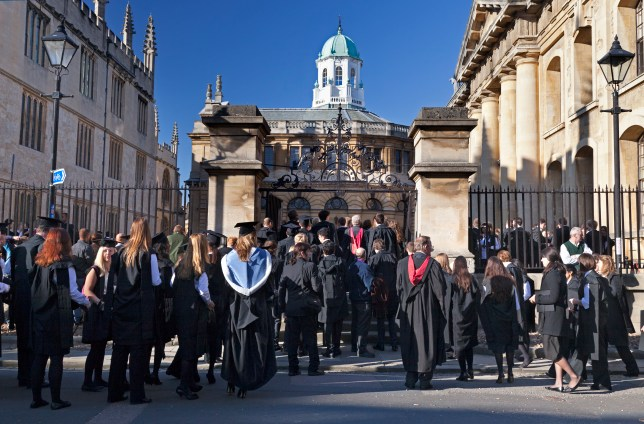 Gowned students at  a grand matriculation ceremony outside the gates to the Sheldonian Theatre, Oxford University.