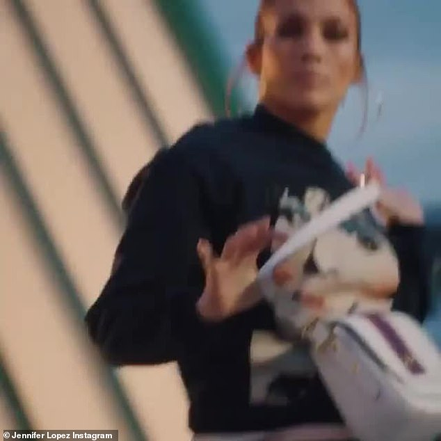 Dancing queen:The future wife of Alex Rodriguez is dancing on a rooftop. Lopez busts out some classic Jenny moves from her In Living Color days then she holds onto a white Coach purse
