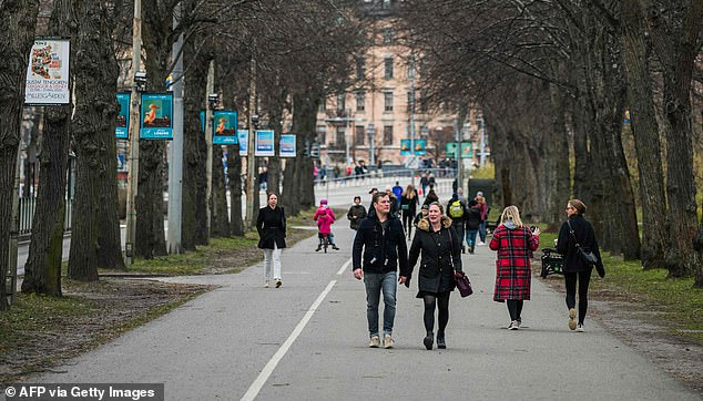People visit Djurgarden park in Stockholm on Saturday, on a weekend when many people across Europe were ordered to stay at home