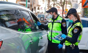 Israeli police stop a vehicle at a checkpoint in Bnei Brak, a city east of Tel Aviv