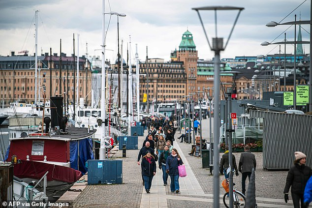Pictured:People walk at Strandvagen in Stockholm on March 28 amid the growing coronavirus crisis
