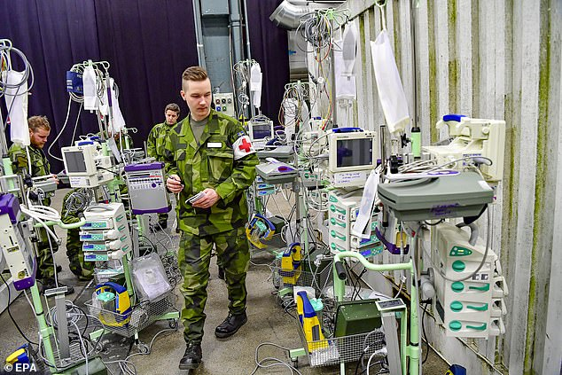 One of the Swedish armed forces personnel looks at medical equipment inside the Stockholm exhibition centre last week