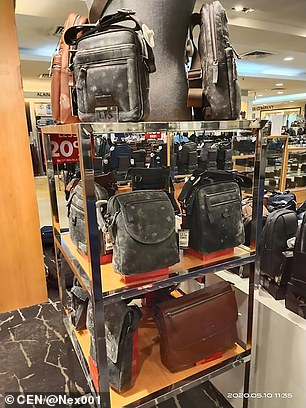 A stand of leather and faux leather items found covered in mould after employees returned to the store in Malaysia after a two-month lockdown due to coronavirus