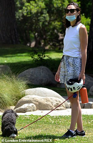 Dog duty: The actress had a black dog on a leash at the park