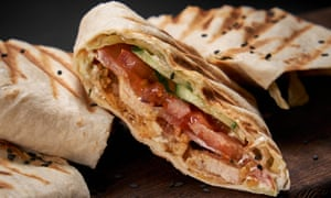 Shawarma sandwich - fill a flatbread with spiced chicken and tomato.