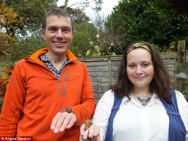 Pictured is the University of Nottingham's Dr Angus Davison (left) who set up the study. He is pictured with Jade Melton, from Ipswich, who gave him a left-sided snail for the research