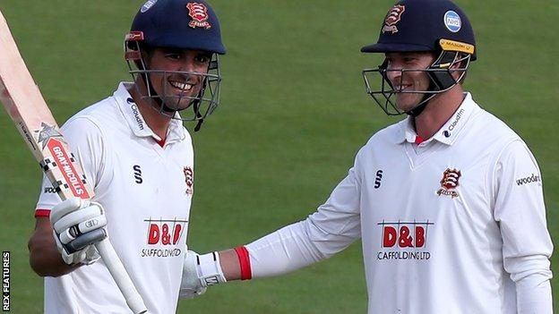 Alastair Cook is congratulated by Tom Westley on reaching his century