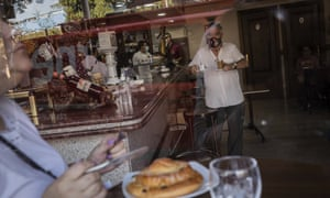Customers have breakfast inside a bar in the southern neighbourhood of Vallecas in Madrid, Spain, Monday, 21 September, 2020.