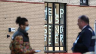 """A sign saying """"help us, send beer"""" at Murano Street Student Village in Glasgow, where Glasgow University students are being tested at a pop up test centre."""