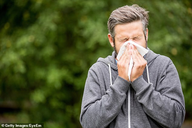 Half of Britons with tell-tale Covid-19 symptoms such as a fever and persistent cough do not have the disease, a study has suggested (stock)