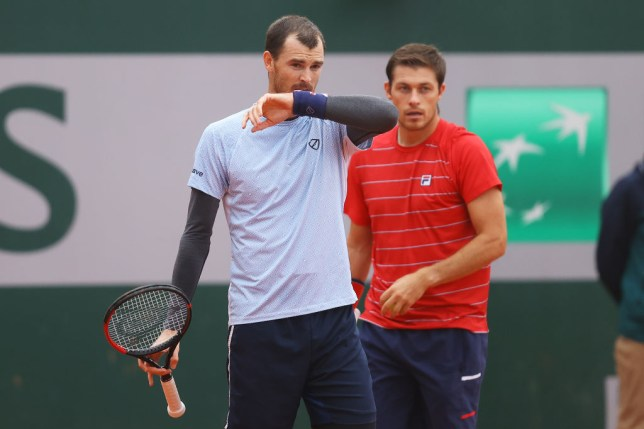 Jamie Murray (L) and Neal Skupski of Great Britain talk tactics in their Men's Doubles first round match against Juan Ignacio Londerp or Argentina and Jiri Vesely of Czech Republic on day three of the 2020 French Open at Roland Garros on September 29, 2020 in Paris, France