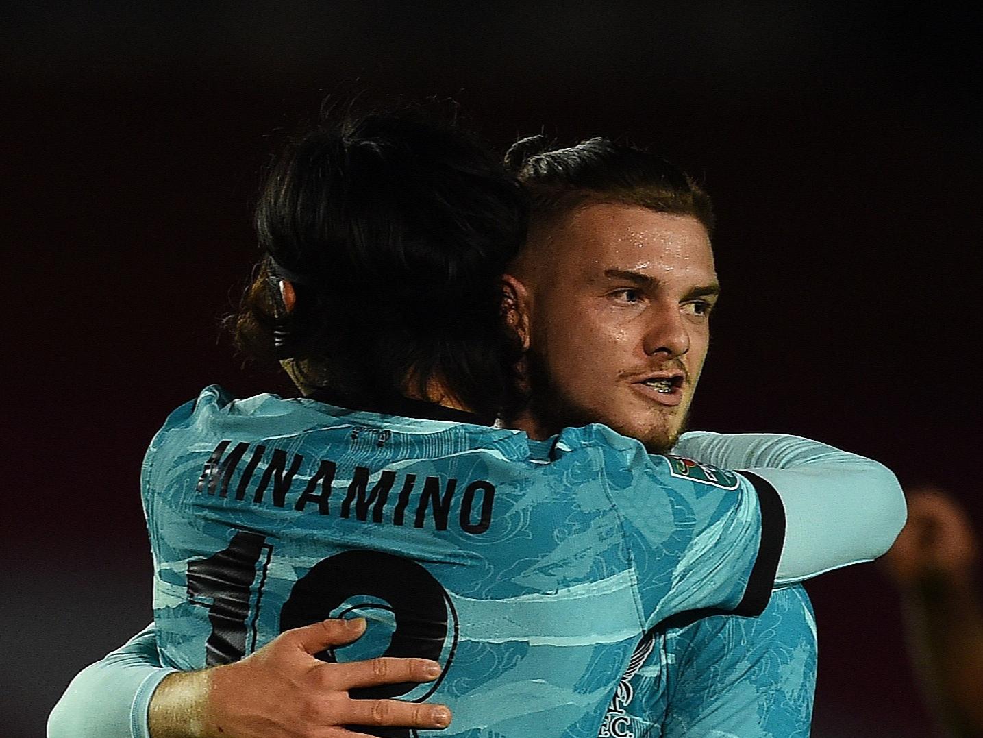 Minamino celebrates as Liverpool score at Lincoln