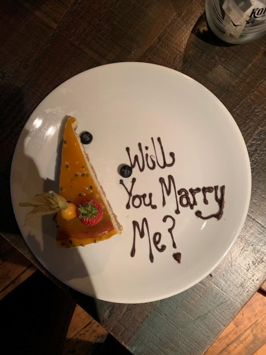 The dessert plate reading 'Will you marry me?'