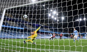 Manchester City's Phil Foden scores his side's second goal past Bournemouth's Mark Travers