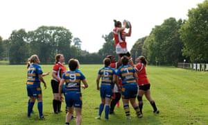 Amateur female rugby union players contest a lineout in Leamington Spa.