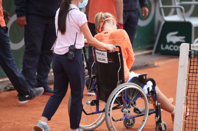 Kiki Bertens of The Netherlands is taken off the court in a wheel chair after winning her marathon match against Sara Errani of Italy in the second round of the singles competition on Court Fourteen during the French Open Tennis Tournament at Roland Garros on September 30th 2020 in Paris, France.