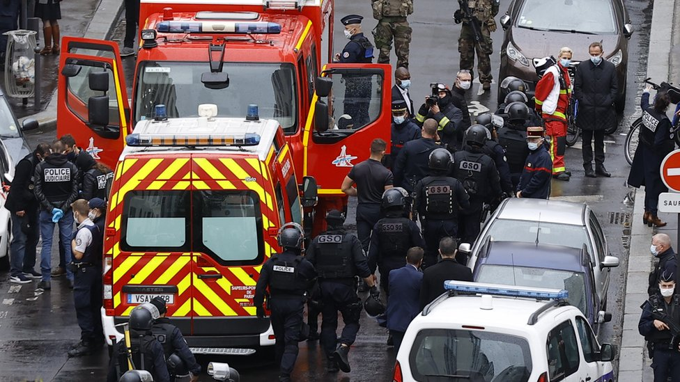 Emergency services work at the site of the knife attack near the former Charlie Hebdo offices in Paris