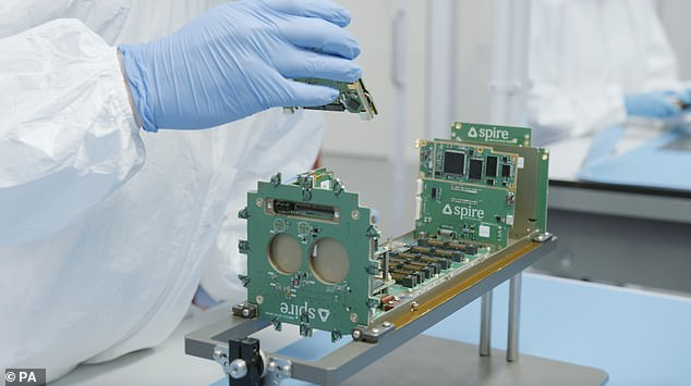 Spire nanosat under construction. Each has an onboard supercomputer with machine learning algorithms that provide predictions of the locations of boats. Two will launch from Russia today