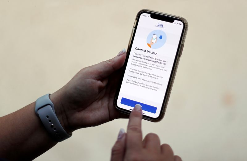 © Reuters. FILE PHOTO: Photo illustration of the NHS COVID-19 contact tracing app