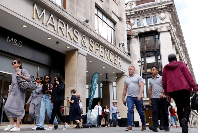 © Reuters. FILE PHOTO: People walk outside the Marks&Spencer shop amid the outbreak of the coronavirus disease (COVID-19), in Oxford Street