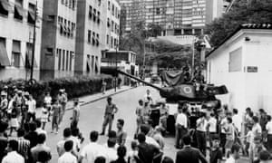 Brazilian army tanks stand in front of Laranjeiras Palace, on 1 April 1964.