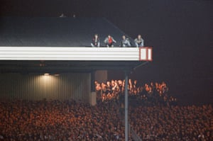 Fans take in the action at Highbury.