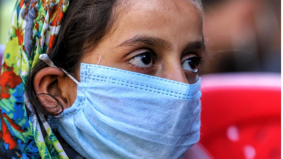 A woman outside a hospital in India