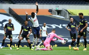 Karl Darlow of Newcastle United saves the ball from the feet Davinson Sanchez.