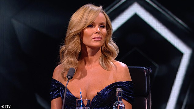 Moved:Meanwhile, Amanda Holden, 49, who looked stunning in a plunging blue gown, is seen nodding along to the music as she watched