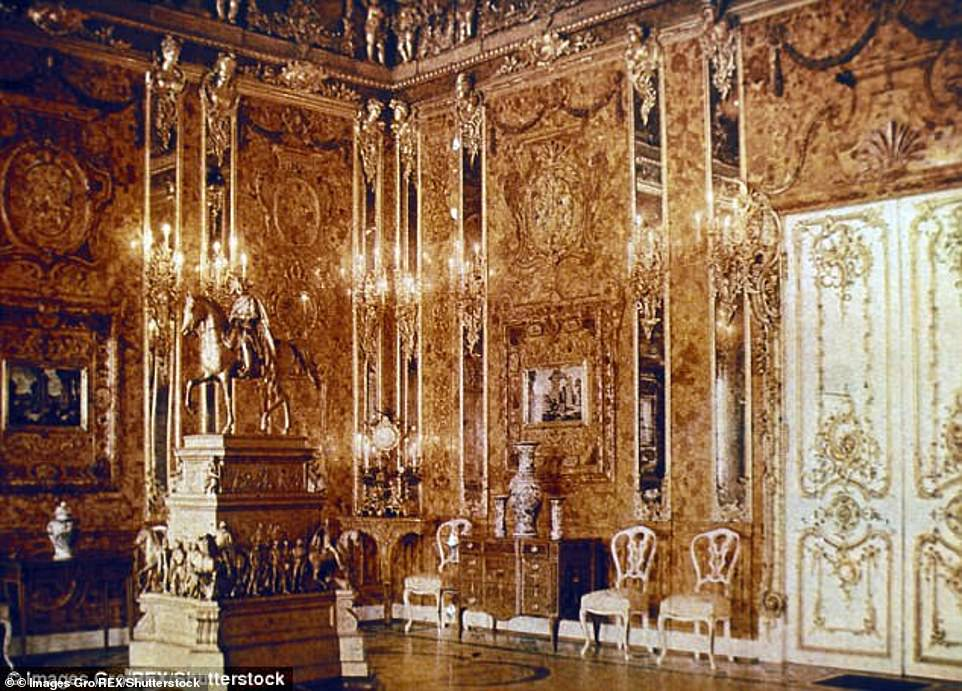 The Amber Room (pictured in Russia in 1917), which was packed with amber, gold and precious jewels, was looted by the Nazis in 1941 and its contents mysteriously disappeared in 1945