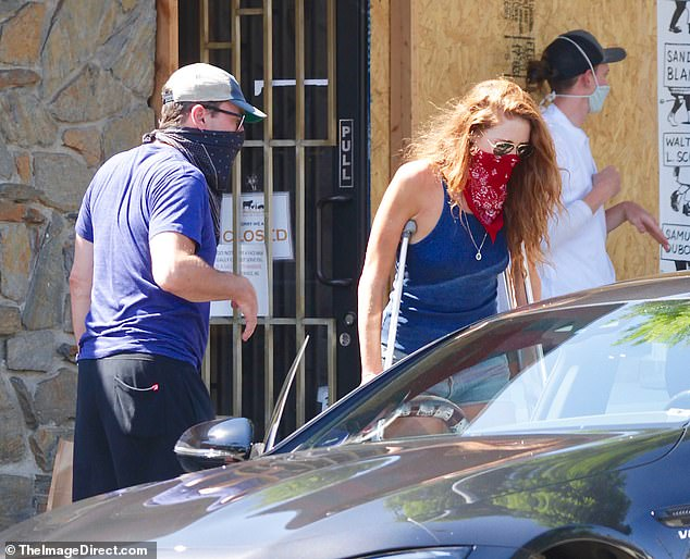 Ouch:Last month, Jon was ever the chivalrous boyfriend last month when opening the car door for her as she used a boot and crutches, appearing to have a foot injury